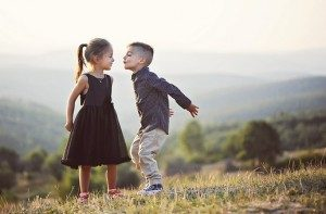 Perfect image for French, Spanish Valentine's Day lesson plans of a boy kissing a girl